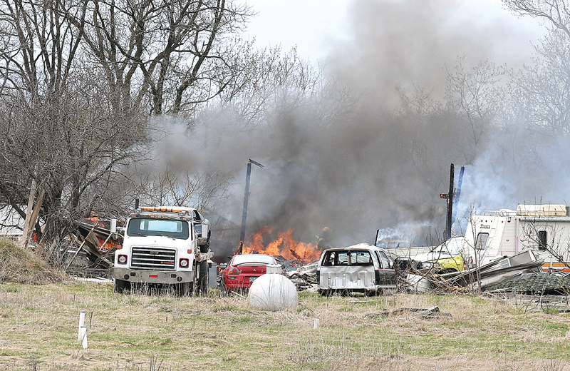 FIRE FROM A BURNING TRASH BARREL spread to grass and into a shed about the size of a double size garage and destroyed the structure. The fire on Sunday afternoon, April 28, was on the Andrew and Kim Ersland property at 2453 170th Avenue in Emerald Township. Using a garden hose, the owner was able to keep the fire from spreading into another garage until the fire department arrived. Glenwood City firefighters were on the scene for almost two hours and they were assisted with equipment from United Fire's Woodville station and Boyceville Fire Department. —photo by Shawn DeWitt
