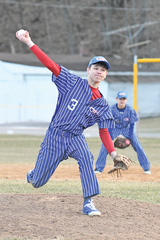 BALL IN HAND — Glenwood City sophmore pitcher Gavin Janson prepared to let fly with a throw during last Tuesday's game in Spring Valley. Janson pitched for four innings and surrendered seven hits and 10 runs in the Hilltoppers' 11 to 4 baseball loss to the Cardinals. —photo by Shawn DeWitt