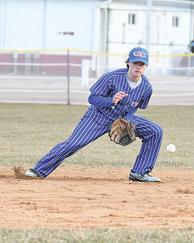 GLENWOOD CITY shortstop Bryce Wickman prepared to snare a first-inning ground ball hit toward him during the Hilltoppers' baseball game in Spring Valley last Tuesday, April 9. Unfortunately, the ball took a big bounce and Wickman was unable to corral it. Glenwood City lost the game 11 to 4 to Spring Valley. —photo by Shawn DeWitt