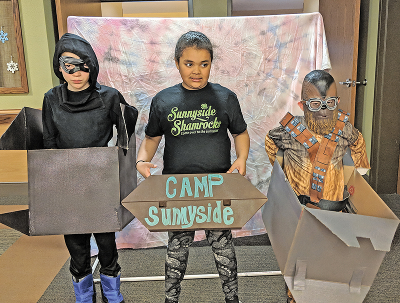 Sunnyside Shamrocks presented their 4-H skit at Glenhaven in preparation for the Mini Talent Explosion. Members are Nicholas Keeley, Gracie Perkins-Greene, and Michael Clark. —photo by Debbie Stevens