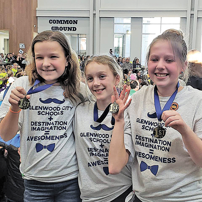 """GLENWOOD CITY Middle School Destination ImaginationTeam """"Owl Let You Know"""" placed first in the regional competition and performed at the State meet in Green Bay on April 13. Team members, from left to right are: Genna Gretzlock, Emily Tews and Elsja Meijer. The team manager was Lisa Berends. —photo submitted"""