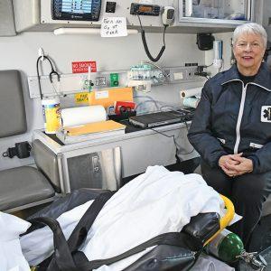 Paula DeWitt in patient area of ambulance