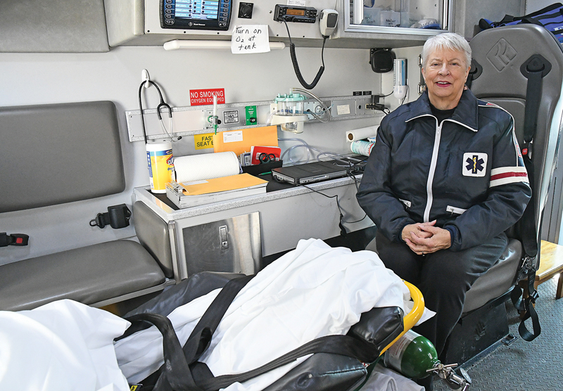 Paula DeWitt in patient area of ambulance
