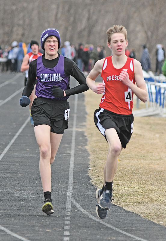 BOYCEVILLE junior Steven Rasmussen ran alongside a Prescott competitor during the boys' 1,600 meter run at last Thursday's St. Croix Central Invitational in Hammond. Rasmussen finished in 17th place. —photo by Shawn DeWitt