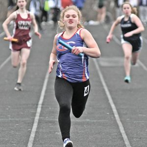 FINAL FEW METERS - Glenwood City freshman Brenna Schwartz prepared to cross the finish line in the girls' 4x100 meter relay race. Schwartz along with Sam Peterson, Alex Swanepoel and Isabel Christmas finished ninth in the race at the St. Croix Central Invitational held Thursday, April 4 in Hammond. —photo by Shawn DeWitt