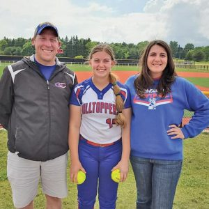 Maggie Wallin (center) with coaches Matthew Schutz and Jessica Erickson