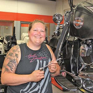 PORTIA Maves poses with a Harley-Davidson motorcycle