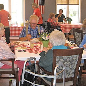 ASSISTED LIVING family picnic enjoyed by family and friends.