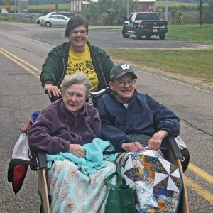 CHRC photo - Joy and Sid enjoying a ride on our new bike being driven by Melissa.