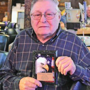 Poker Run Reuben Knutson with plaque