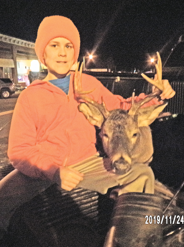 Bradley Maes with buck