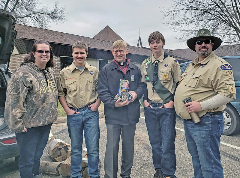 Boy Scouts popcorn donation to Holy Cross