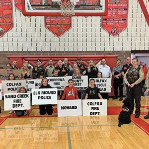 MEMBERS OF the Colfax Fire Department, Colfax Rescue Squad, Dunn County First Responders and Dunn County Sheriffs Department were honored during the December 5 game between Colfax and Elk Mound girls' basketball. —photo submitted