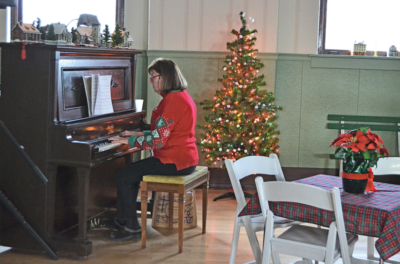 Joan Foris plays piano at Municipal Building Open house