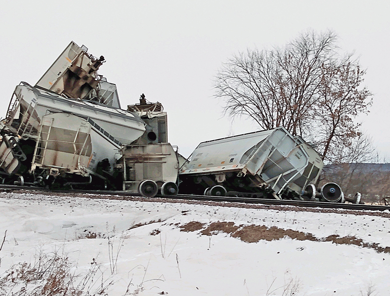 A pile of railroad cars train derailment Knapp WI