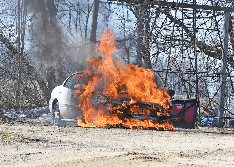 CONSUMED BY FIRE — The Glenwood City Fire Department was called to 1083 Rustic Road in the Town of Springfield shortly before noon last Wednesday, April 1 for a vehicle on fire. Firefighters arrived on scene to find the vehicle, a 2003 Buick LaSabre, fully engulfed in flames and were quickly able to extinguish the fire but the car was a total loss. The vehicle was owned by Shane and Cherri Peterson and their son Kyle Peterson was attempting to jump start the car when it caught fire. —photo by Shawn DeWitt