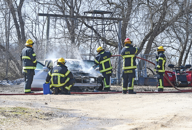 GLENWOOD CITY Firefighters used water and foam to put out the remaining fire that destroyed a car owned by Shane and Cherri Peterson. The department was paged out to the vehicle fire shortly before noon on Wednesday, April 1 at the Peterson's Town of Springfield home. —photo by Shawn DeWitt