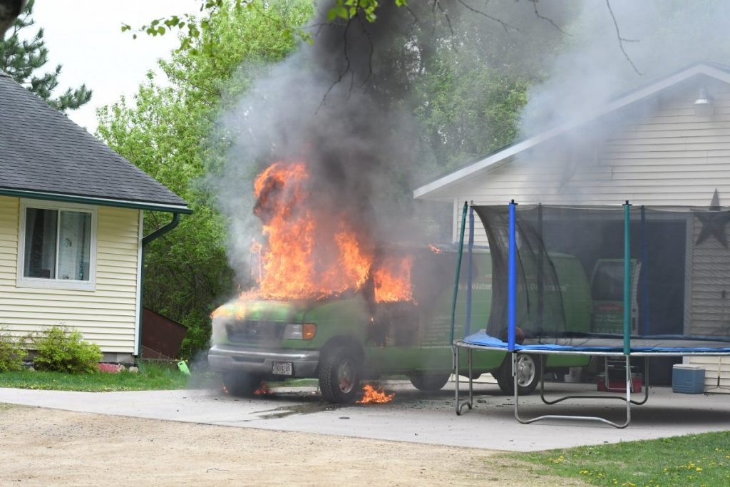 A SERVICE truck from SERVPro of Barron, Dunn and Ruck Counties, headquartered in Boyceville, caught fire late Friday morning, May 22 while on a service call at the home of Brian and Nicole Brite residence on County Road G in the Town of Glenwood. —photo by Shawn DeWitt