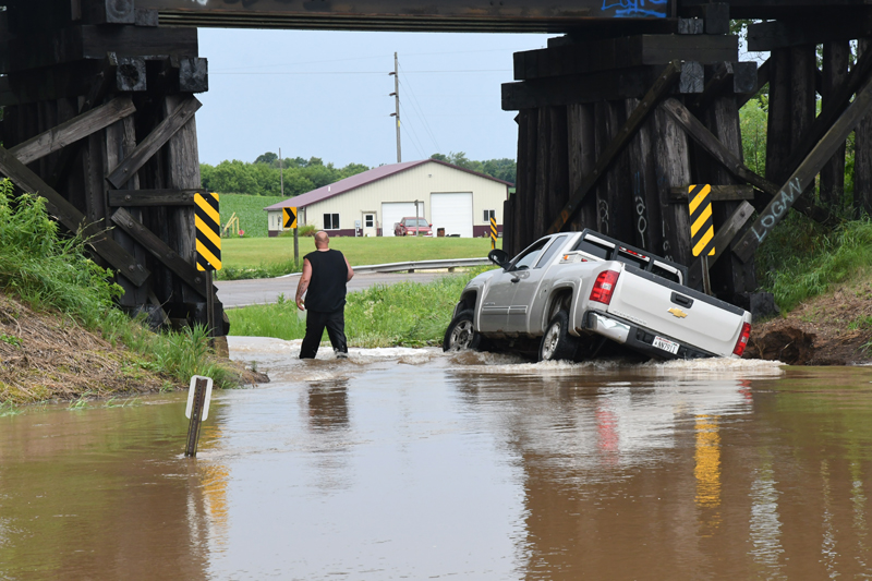 Area Flooding Truck stuck under tressel