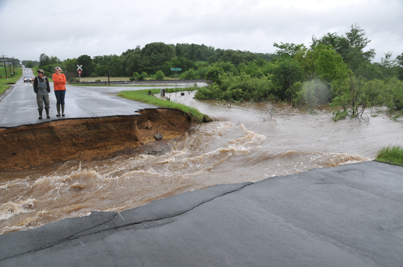 BIG HOLE IN 150th AVENUE — Flood-waters took out two culverts under 150th Avenue near the Dunn County line in the Town of Glenwood and washed the culverts several hundred yards downstream. —photo by Carlton DeWitt