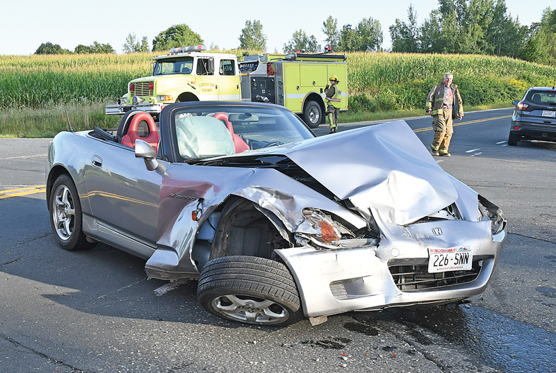 THE DRIVER of this Honda S2000 convertible, Walter Mauser of Somerset, was able to walk away from this accident that happened early Sunday evening, August 16 in the Town of Glenwood. Mauser stated that he was traveling north along State Highway 128 when a van, driven by a unidentified young lady, traveling on 160th Avenue failed to yield at the stop sign and was t-boned by Mauser. The van came to rest in the northwest ditch of the intersection while Mauser's vehicle remained on the roadway. Fortunately, no serious injuries were reported from the accident that occurred around 6:30 p.m. Both drivers were the lone occupants of their respective vehicles. Agencies responding to the scene included the Glenwood City Fire Department and EMS, the St. Croix County Sheriff's Office and the Wisconsin State Patrol. —photo by Shawn DeWitt