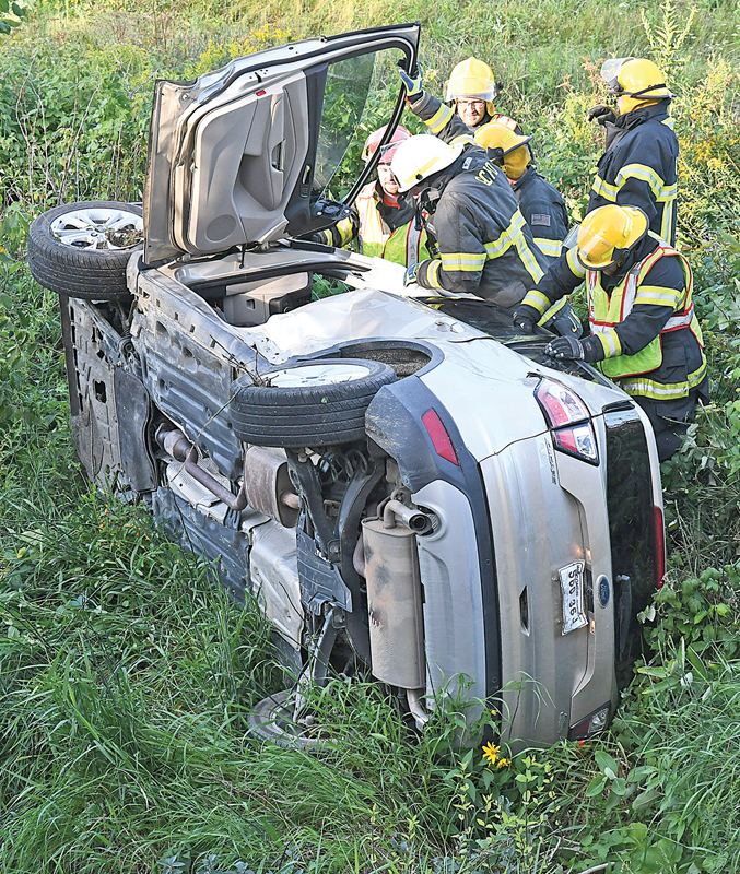 MEMBERS of the Glenwood City Fire Department checked a van, that was involved in a two-vehicle accident Sunday, August 16, for any addittional victims. The crash occurred around 6:30 p.m. at the intersection of State Road 128 and 160th Avenue in Glenwood Township. The female driver of the van was transported to an area hospital by the Glenwood City Ambulance for treatment of her injuries. The driver of other vehicle (a Honda convertibale), Walter Mauser of Somerset, was evaluated and released at the scene. —photo by Shawn DeWitt