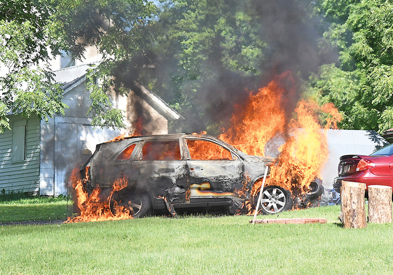FLAMES consumed this minivan at a residence in the Village of Downing Saturday, August 15. The Glenwood City Fire Department was paged to 506 Wilson Street in Downing shortly before 10:00 a.m. for a car fire and arrived on scene to find the vehicle, owned by Amy Steies, fully engulfed in flames. It took only a few minutes to extinguish the blaze but the vehicle was a total loss. —photo by Shawn DeWitt