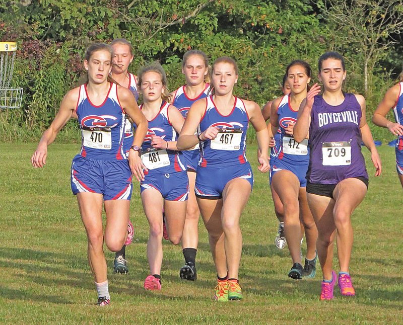 AND THEY ARE OFF — A large group of Glenwood City girls that also included a Boyceville runner sprinted away from the starting line at last Thursday' D-SC West Pod cross country meet at Glen Hills County Park. From left to right are: Bella Simmons, Natelle McCarthy, Savanna Millermon, Kinzie Strong, Kendall Schutz, Ella Knops and Shiloh Wheeldon. Simmons, Schutz and Strong finished the race first, second and third respectively. —photo by Amy Corr