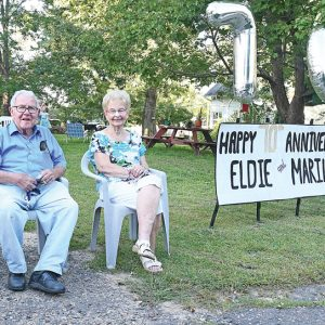 70 YEARS OF WEDDED BLISS — Family members organized and held a 70th Wedding Annivesary drive-by celebration for Eldon (Eldie) and Marilyn Wheeler (pictured above) on Wednesday evening, September 2. The event drew dozens of vehicles including Boyceville fire trucks and ambulance, Dunn County Sheriff's Patrol cars, private cars and trucks and some UTV's. The line of vehicles traveled down the alley behind the Stevens' home in Wheeler. —photo by Shawn DeWitt