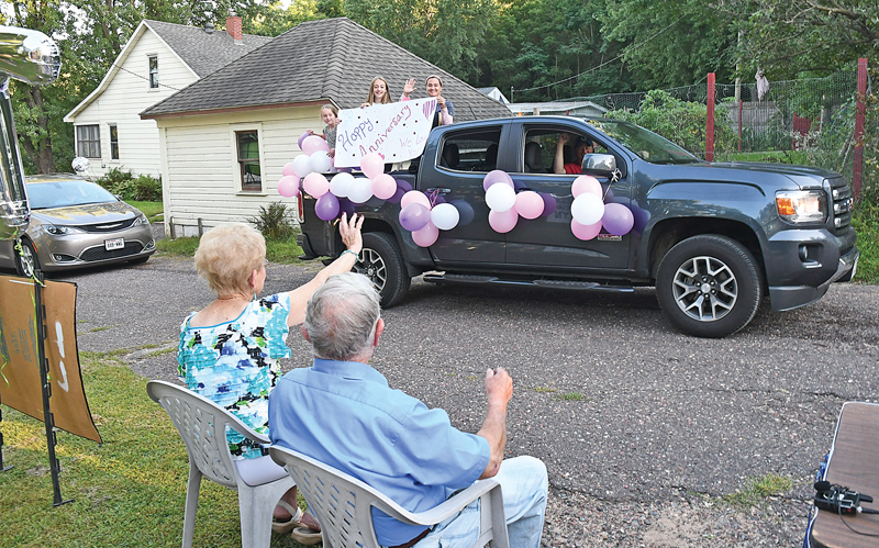 A PICK-UP load of happy wishes. Marilyn and Eldie Stevens waved a this group of three young ladies that drove by their Wheeler home Wednesday, September 2 holding a sign wishing the couple a Happy 70th Anniversary. —photo by Shawn DeWitt
