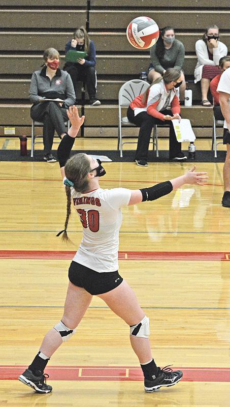 no 30 senior Anna Geissler shows off her serving form