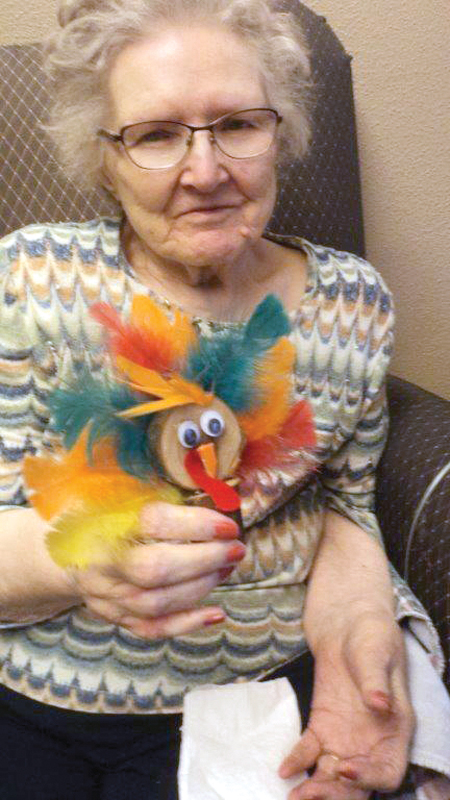 Olga Waters with her colorful Thanksgiving turkey. —photo submitted