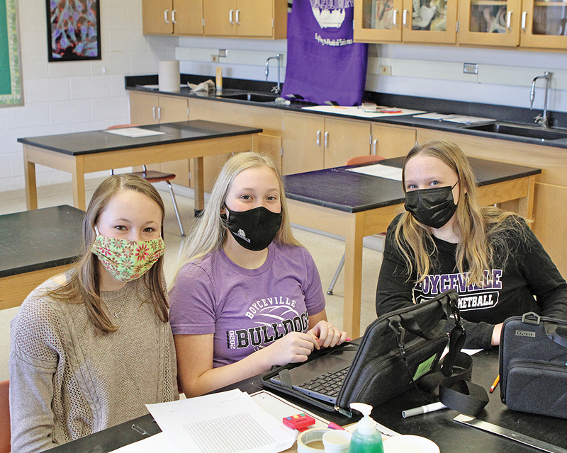 IN THIS event, Experimental Design, asks students to design an experiment, run it and write a lab report for it. Middle schoolers (from left to right) Chelsi Holden, Delanie Olson and Zoey Hellendrung are about to begin the activity. —photo by Steve Duerst