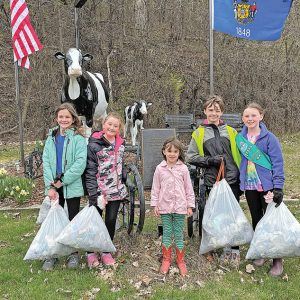 GC Jr Girl Scouts clean trash along Tiffany Creek