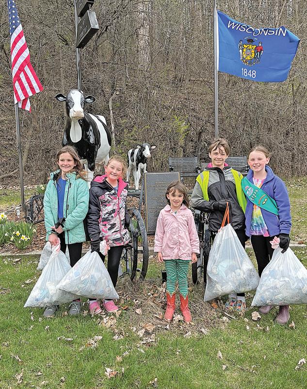 GC Jr Girl Scouts clean trash along Tiffany Creek