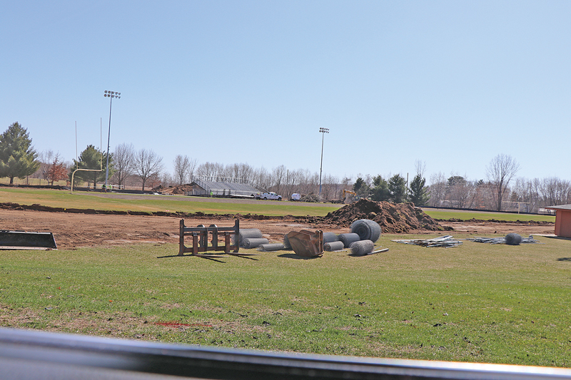 Work on Elk Mound football field and track