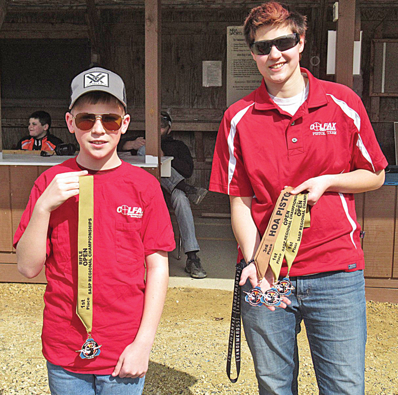 CHAMPIONS — Alex Johnson and Nokomis Nosker of the Colfax Scholastic Action Sheeting Team display the medals they earned at the 2020 Scholastic Action Shooting Program Fall Classic regional shoot. Johnson received a first place medal for being on the winning pistol caliber carbine open squad. Nosker earned first place medals for being on the winning pistol caliber carbine open squad and for being on the winning optics rifle open squad. She also received an individual third place medal for iron sight pistol, women's division. —photo submitted