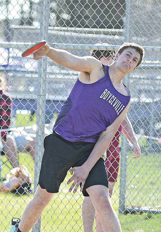 BULLDOGS' junior John Klefstad lets loose with a discus throw during a Dunn-St. Croix Quad meet held in Boyceville April 29. Klefstad finished sixth with a best effort of 80'. —photo by Shawn DeWitt