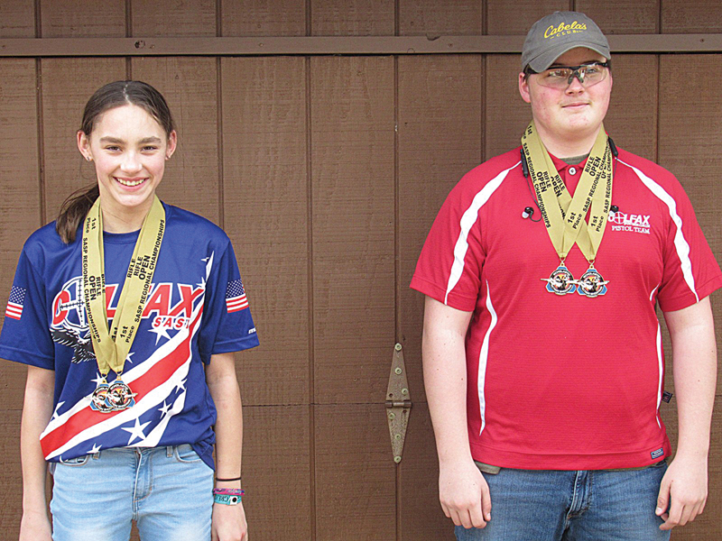 Big Winners — Evelyn Doyle and Kyle Weller, Colfax Scholastic Action Shooting Team, were both on the first place winning pistol caliber carbine open squad and the first place optics rifle open squad, at the 2020 Scholastic Action Shooting Program's Fall Classic regional shoot last October. The medals were just awarded this spring. —photo submitted