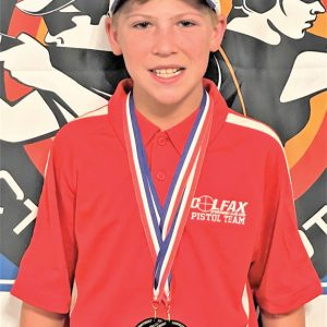 AT THE Scholastic Action Shooting Program's national match, Alex Johnson claimed first place for men's rookie optic rifle and men's rookie PCC. —photo submitted