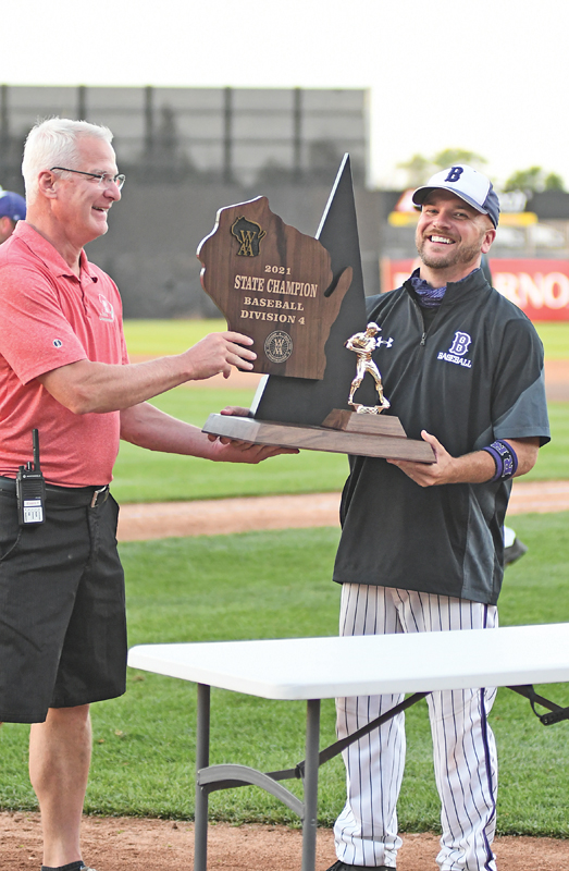 BIG SMILE — Head coach Michael Roemhild (right) wore a big smile as he accepted the Division 4 state baseball championhsip trophy from WIAA deputy director Wade Lebecki following Boyceville's 4-0 win over Rosholt Monday evening, June 28 to claim the program's first state title. —photo by Shawn DeWitt