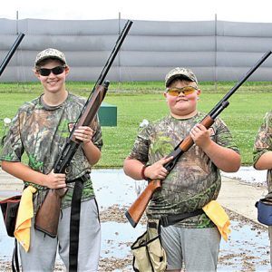 COLFAX Scholastic Trap Team members at the national shoot were (from left to right) Alex Johnson, rookie; Nokomis Nosker, senior varsity; Beaumont Zelm, rookie; Patrick Hafemann, intermediate/advanced. There were as many adults in Ohio providing support was team members, including volunteers Kyle McLain and Autumn Wildfeuer, assistant coach Michael Hafemann, and head coach Jim Nosker. Nokomis Nosker is also a registered assistant coach. —photo submitted
