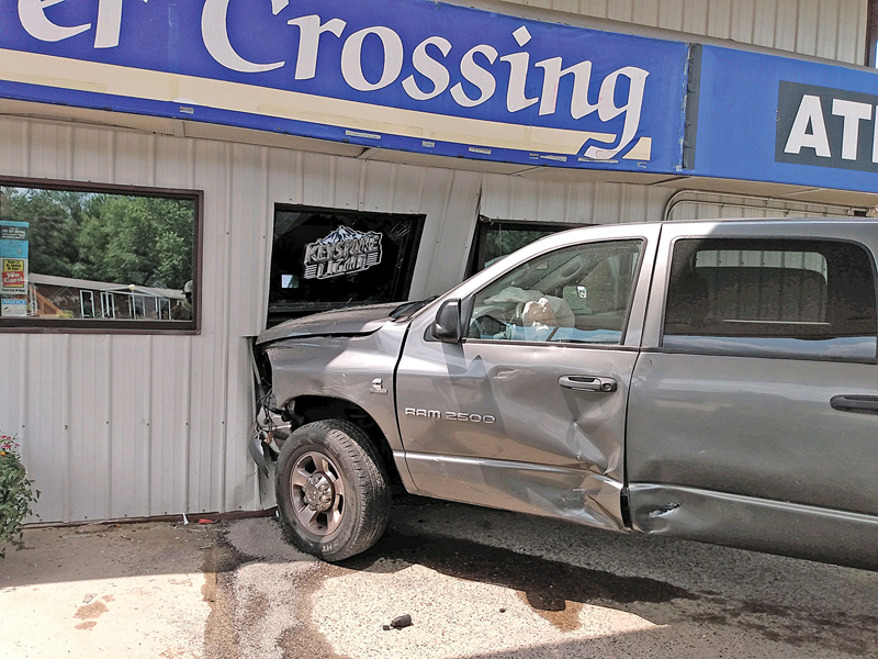 THE BRIDGE STOP convience store and gas station received extensive damage last Tuesday afternoon, July 13 when the driver of this truck crashed into the building. Allegedly, the male driver ran a stop sign while heading west on State Road 170, proceeded into the intersection with State Highway 25 when he struck a trailer being pulled by another truck, glanced off and went on to crash head on into the gas station. A worker in the store was injured. The Boyceville Fire Department and Colfax Ambulance responded to the scene shortly before 1 p.m. —photo submitted