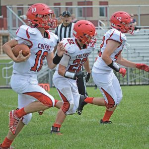 THE VIKINGS' Brian Tuschl zipped around the right side for a long gain against Eleva-Strum Saturday morning, August 28 in Strum. Leading the way was Kade Anderson (#22). —photo by M. Kruger