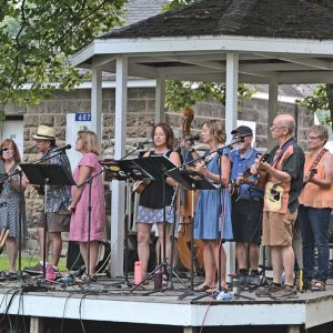UKULELE KLUB — Music in the Park in Tower Park next to the Colfax Municipal Building featured the Ukulele Klub out of Eau Claire on Thursday evening, July 29. Music In the Park is sponsored by the Colfax Woman's Club. The Ottersons will play August 5. —photo by LeAnn R. Ralph