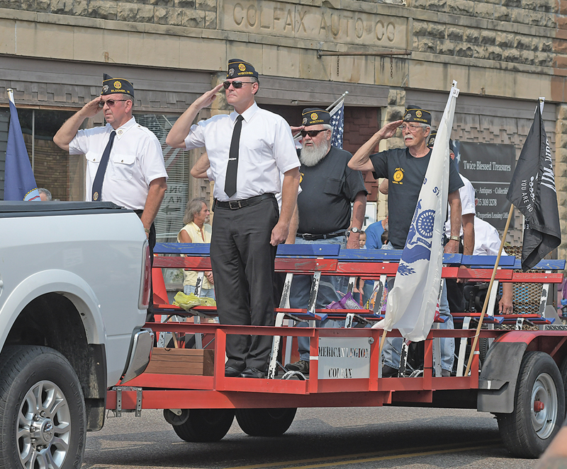 AMERICAN LEGION — Veterans from the Russell-Toycen American Legion Post 131 of Colfax were part of the Colfax Firefighters' Ball parade on Saturday, September 11. Above, they stood at attention during the singing of the National Anthem. —photo by Shawn DeWitt