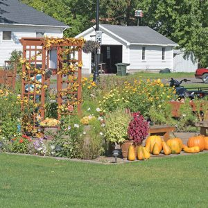 FRIENDSHIP GARDEN in Boyceville has taken on a dinstinctive fall theme with pumpkins and colorful foliage. September 22 marks the start of fall. —photo by Shawn DeWitt