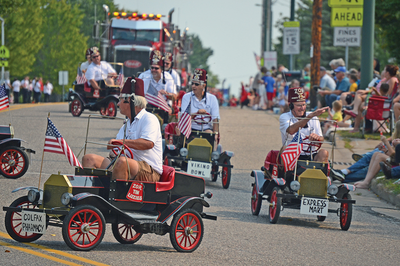 TIN LIZZIES — The ZOR Shriners Tin Lizzies raced around the street during the Colfax Firefighters' Ball parade on Saturday, September 11. —photo by LeAnn R. Ralph