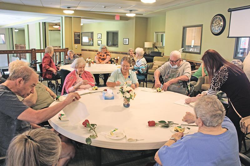 RETIREMENT CELEBRATION — Doris enjoyed cake with the residents during her retirement celebration September 17. —photo by Missy Klatt.