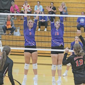 GLENWOOD CITY'S Amalia Draxler (left) and Arianna DeSmith attempted to block this shot during a volleyball match in Elk Mound. —photo by Shawn DeWitt